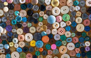 Group of retro colorful fashion buttons on a board